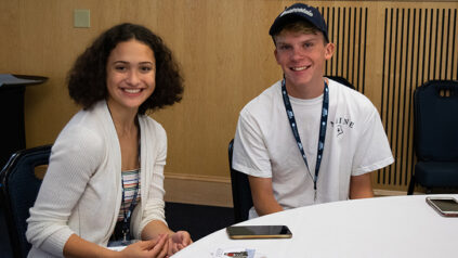 two students sitting at table at Early College orientation