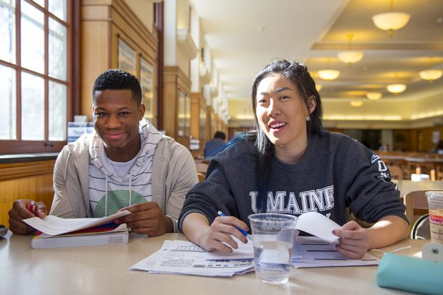 male and female student in library