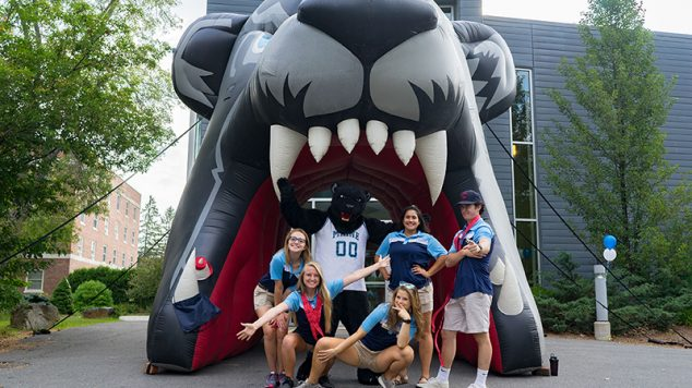 Orientation Volunteers posing in from on large inflatable UMaine bear