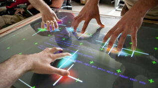 hands on a multi-touch table