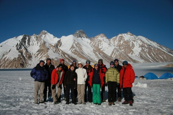 field group in front of mountains