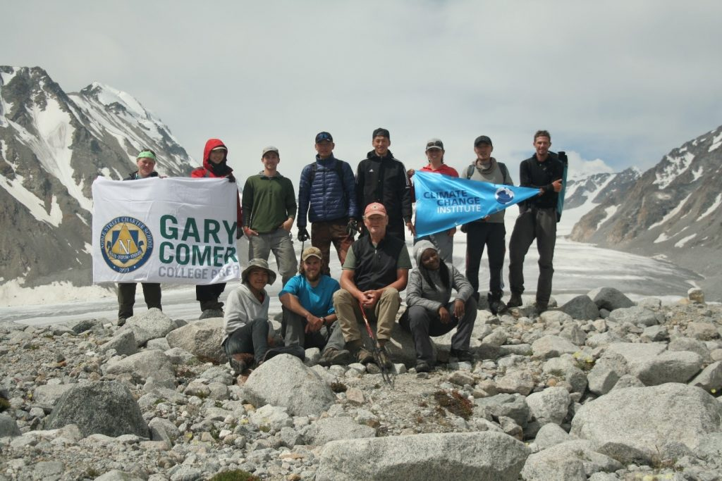 Field team members in front of a glacier. Photo credit: Kevin Stark