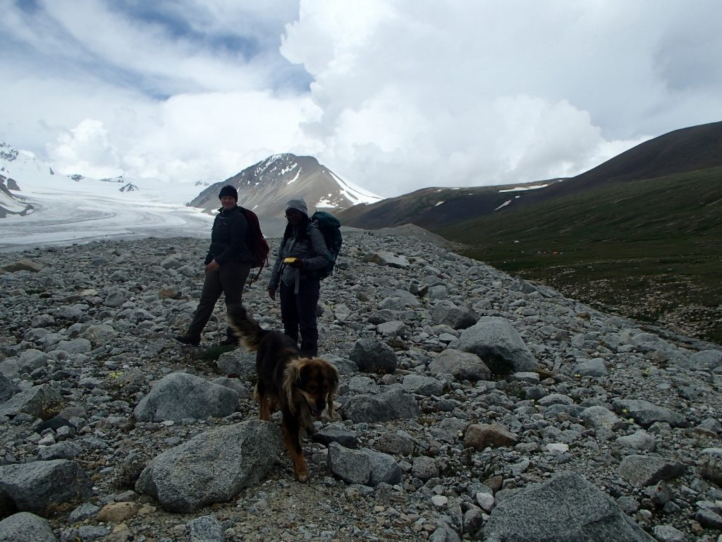 "Destiny Washington and Jessica Stevens mapping with the help of ""Simba"" the camp dog. Photo credit: Mariah Radue"