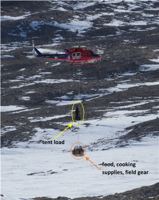 Figure 2: After the helicopter crew dropped off Dr. Stone, Trevor, Dr. Hall, and myself at our first field site (Diamond Hill), they flew back to the fuel cache where a twin otter brought the remainder of our gear. The gear was then tied into a sling load, pictured above, with the tents on the top and our food, cook-kit, and field supplies on the bottom.