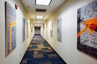 Photo of a hallway with art hanging on walls