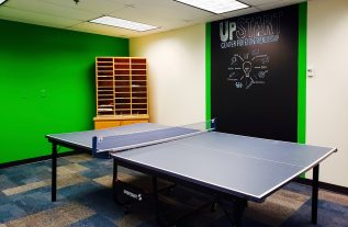 Photo of room with pin pong table