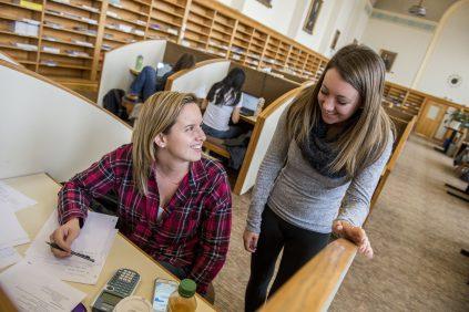 Peer Tutor Students in Library