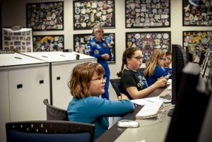 Girls at the Challenger Learning Center working on computers