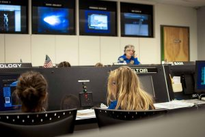Girls working on computers during a challenger learning center mission