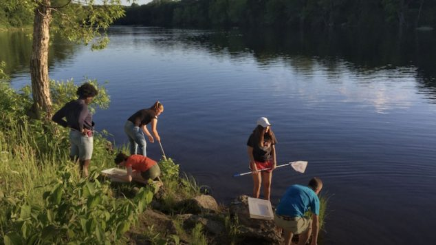 Image of students testing river water