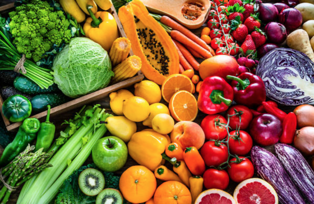 diverse arrangement of healthy foods ranging in colors and sizes