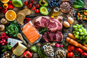 Food backgrounds: top view of a rustic wooden table filled with different types of food.