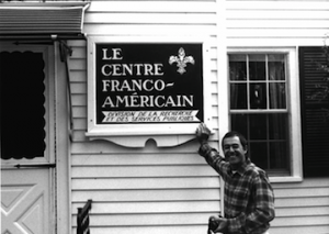 Le Centre Franco Americain - man with sign