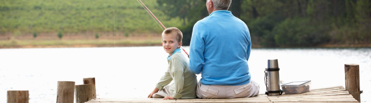 Grandfather fishing with gradson