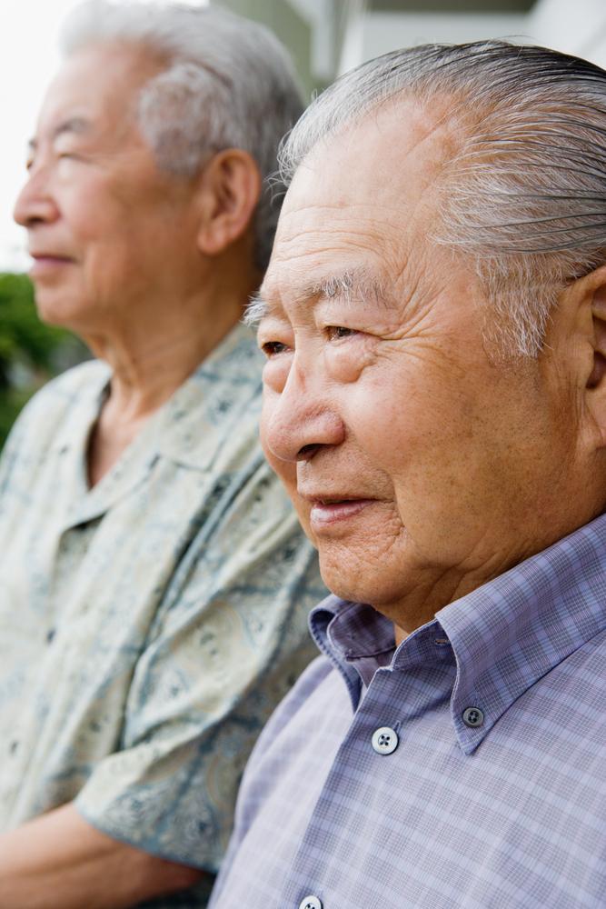 Elderly men sitting side by side