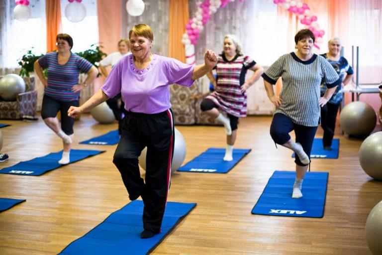 Group of elderly women exercising