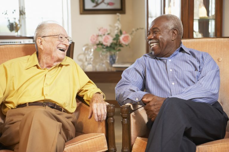 Elderly men sitting having a conversation