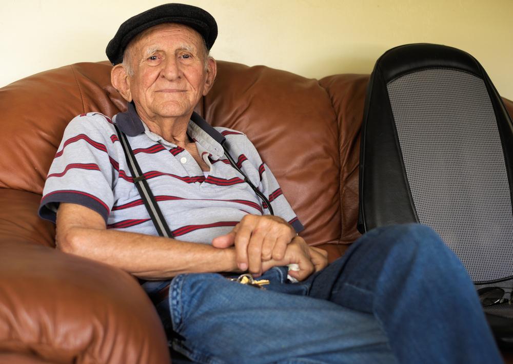 Elderly man sitting in chair