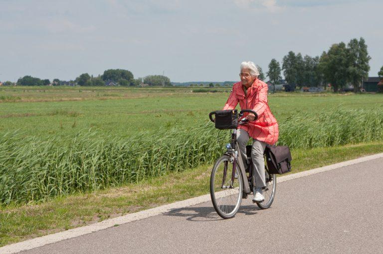 Elderly woman riding bike