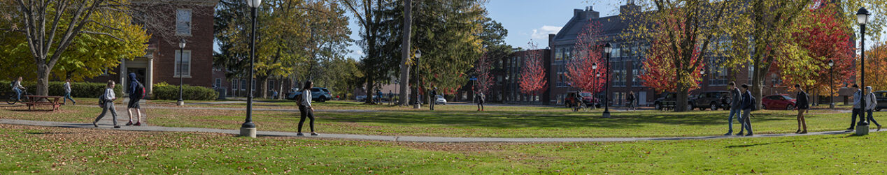 panoramic view of students walking on campus