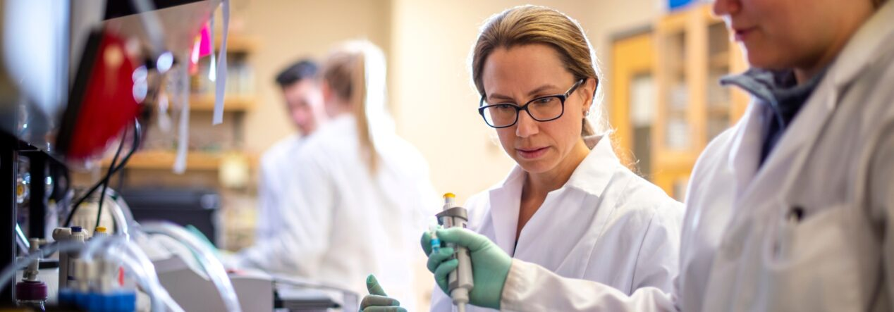 people in a lab setting working in pairs
