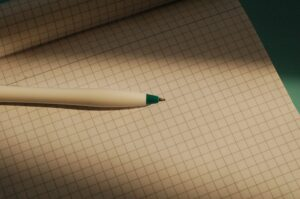 Grid paper notebook with pen