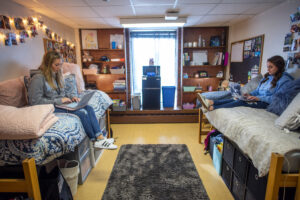 Knox Hall female nursing students in decorated college residence hall room