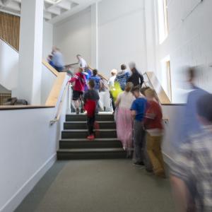Children in CCA stairway