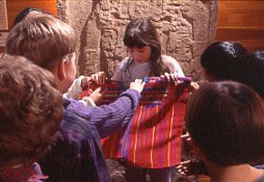 Students examine traditional Maya clothing