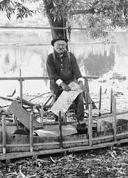 man building canoe