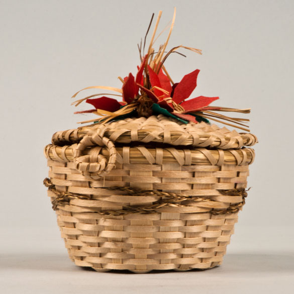 basket with red flower design on lid
