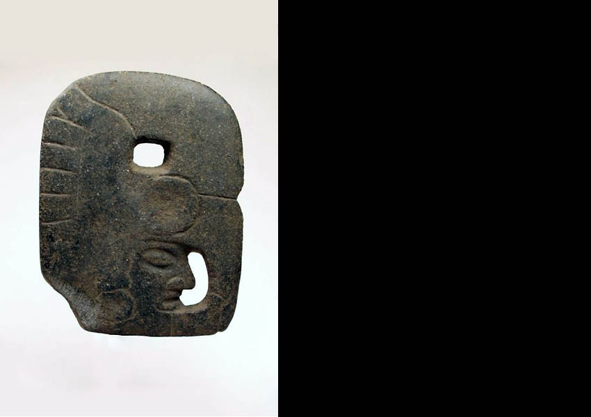 Stone hacha with traces of red paint, Early Postclassic south coast of Guatemala