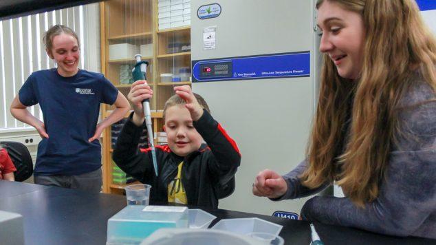 pipette child in lab