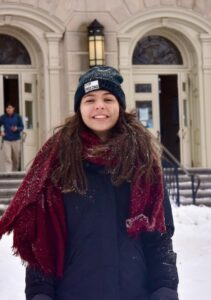 student in front of folger library