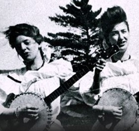 2 women playing banjos photo