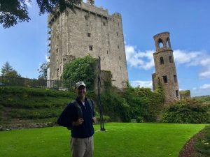 student in front of a castle in ireland