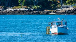 Lobster fishing boat in autumn coastal Maine, New England