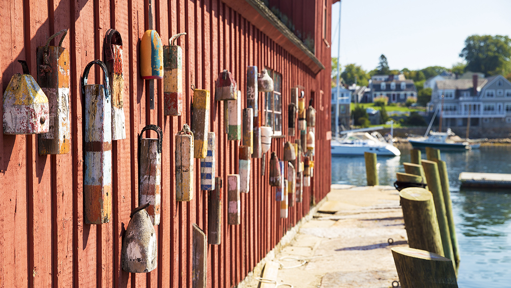 red wooden wall of the house with buoys