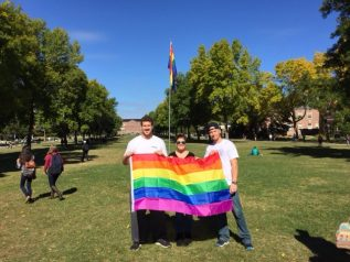 MAAV members holding rainbow flag