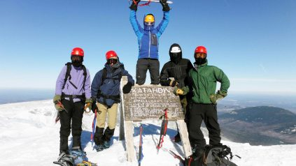 Students at Katahdin Mountain top in winter