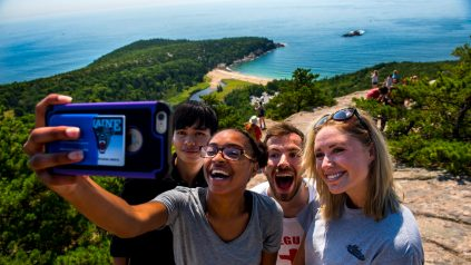 selfie group on a mountain