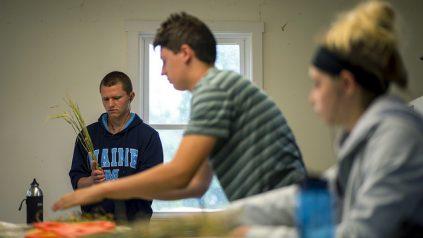 Students sorting grain.