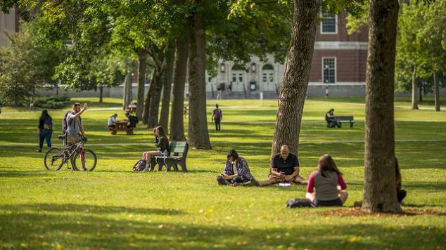 Many students enjoy the nice weather on the lawn.