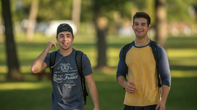 Two friends walking on the mall.