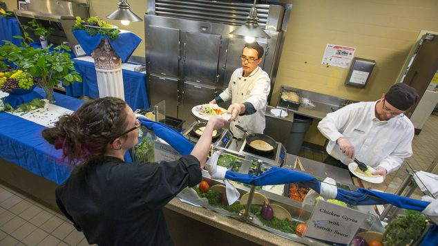 Meal Plans: Photo showing student being handed plate of food from York Dining staff