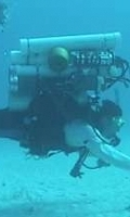 Photo of Dr. Emmanuel Boss SCUBA diving.
