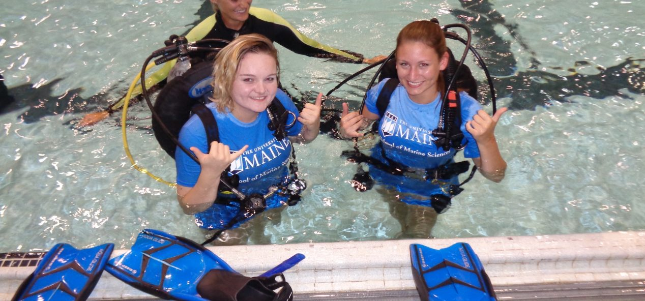 Picture of two students with dive gear and an instructor in a pool at UMaine.