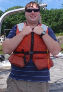 Photo of Adrianus Both on the dock wearing a life jacket.