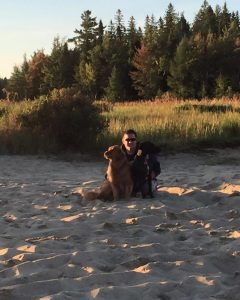 Matt Nixon on the beach with two dogs.