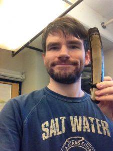 Photo of Brian Preziosi holding a razor clam.